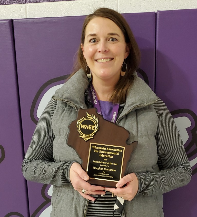 Photo of Meaghan Gustafson with award